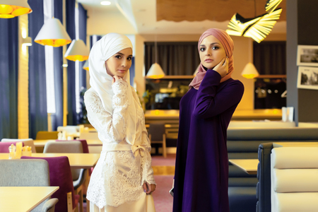 Two beautiful Muslim women in modern oriental clothes, Russia 스톡 콘텐츠