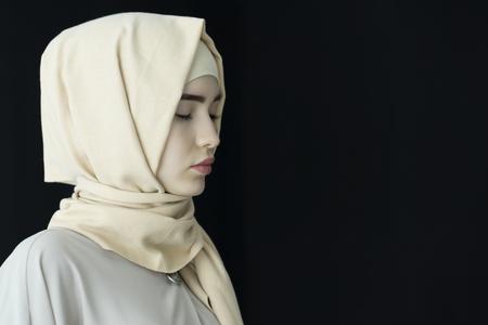 Portrait of a beautiful Muslim woman wearing hijab, isolated, Ufa