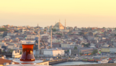 glass of Turkish tea against the background of the center of Istanbul and Bosporus, Turkey