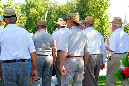 ceremonial clothing: Seniors group monitors  the City Festival in Lithuania. Editorial