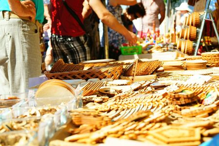 disctrict: City celebration fair. Joniskis, Siauliai disctrict, Lithuania. Wooden kitchen utensils outdoor marketplace. Stock Photo