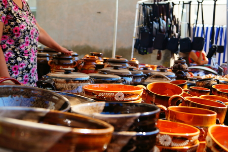 crafted: Buyers interested in clay pots at the fair during the city celebration.