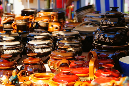 Buyers interested in clay pots at the fair during the city celebration.