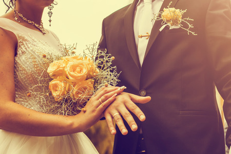 Newly wed couples hands with wedding rings. Stock Photo