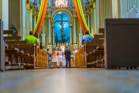 Joniskis Sant Church of the Assumption of the Virgin Mary. Lithuania. The interior. Ecclesiastical ceremony.