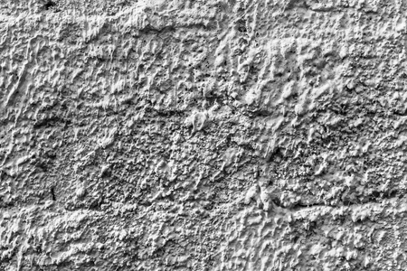 White concrete wall with natural texture and cracks on the surface as background.