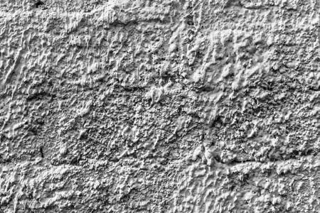 Witte betonnen muur met natuurlijke textuur en scheuren op de oppervlakte als achtergrond. Stockfoto
