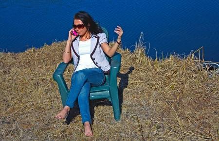 Business Woman on Phone outdoors. Stock Photo