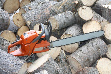 Chain Saw with Firewood Stock Photo