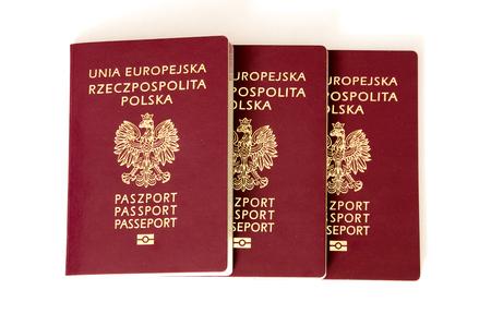 Polish biometric passports on white background. Banco de Imagens