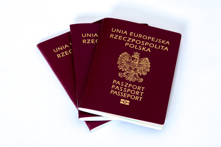 Three biometric passports on white background. Banco de Imagens