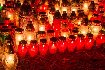 Graveyard candles at night. Stock Photo