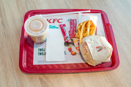 Gdansk, Poland - December 2, 2017: Grander Burger meal with drink and french fries at KFC (Kentucky Fried Chicken) restaurant. Editorial