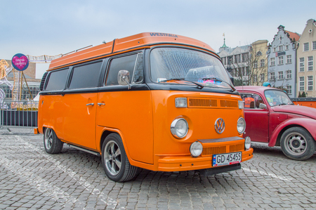 Gdansk, Poland - January 14, 2018: Orange historical Volkswagen Transporter at the Great Orchestra of Christmas Charity in Targ Weglowy in Gdansk.