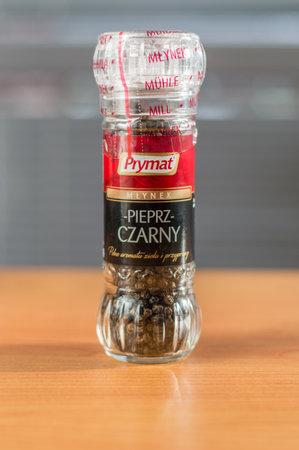 Pruszcz Gdanski, Poland - January 25, 2018: Prymat pepper in pepper mill on wooden table. Редакционное