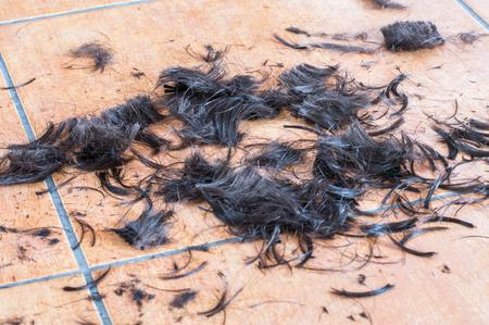 Human hair clippings on the floor.