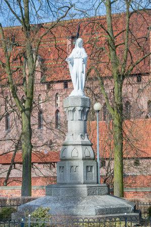 Malbork, Poland - April 4, 2017: Jesus statue next to the Roman catholic church of John the Baptist.