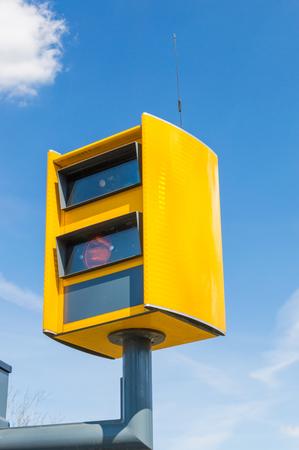 Yellow traffic enforcement camera in Poland.