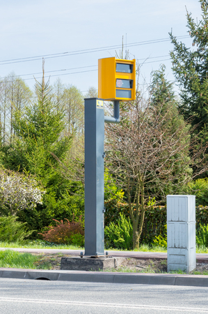 Deblin, Poland - April 19, 2018: Yellow speed camera near trunk road number 48 in Poland.