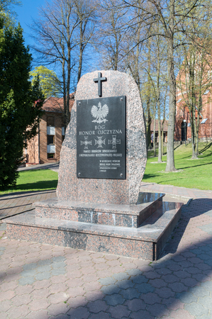Ostroda, Poland - April 20, 2018: Monument to commemorate the defenders of the sovereignty and independence of the Republic of Poland. Editorial