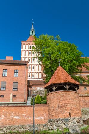 Tower of roman catholic Cathedral. Basilica of St. James the Apostle in Olsztyn, Poland. Stock Photo