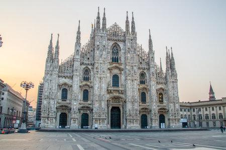 Milan, Italy - May 31, 2018: Famous Duomo cathedral at sunrise. Editöryel