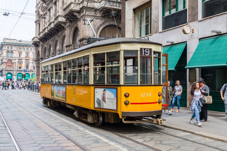 Milan, Italy - May 31, 2018: Historic yellow tram on the street in Milan.