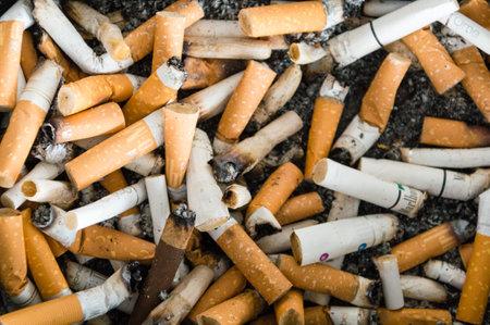 Barcelona, Spain - June 7, 2018: A lots cigarette butts.