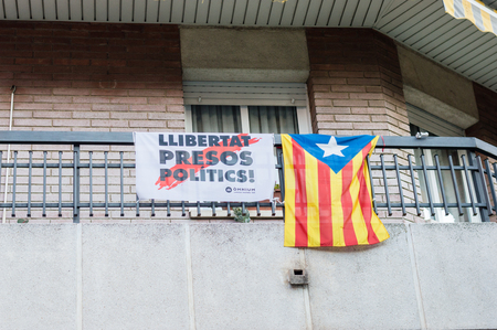 Barcelona, Spain - June 7, 2018: Llibertat Presos Politics (Freedom for Political Prisoners) and Estelada. Estelada is unofficial Catalan flag.