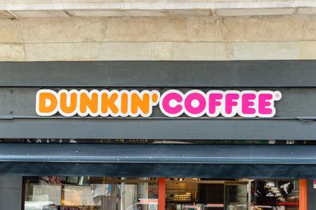 Barcelona, Spain - June 8, 2018: Dunkin Coffe logo and sign in  Barcelona. Editorial