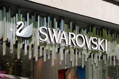 Barcelona, Spain - June 8, 2018: Swarovski swan symbol and logo on a store in Barcelona.