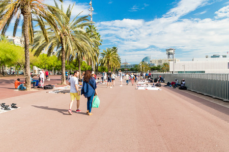 Barcelona, Spain - June 7, 2018: Alley with street vendors next to the port of Barcelona.