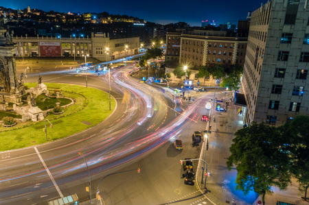 Barcelona, Spain - June 8, 2018: Car light trail at Placa dEspanya at night. 報道画像