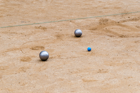 Metallic petanque balls and jack ball.