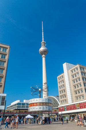 Berlin, Germany - August 16, 2018: The Berlin TV tower overlooks the World Clock at Alexanderplatz.