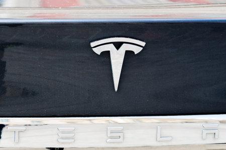 Potsdam, Germany - August 17, 2018: Tesla Motors logo on a black car. Editorial