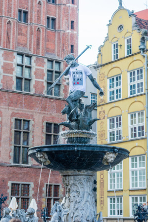 Gdansk, Poland - August 25, 2018: Neptune wearing Konstytucja T-Shirt at Historic Neptunes Fountain in Old Town of Gdansk. Konstytucja means Constitution in Polish language.
