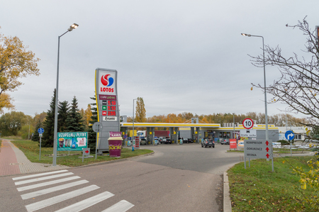 Pruszcz Gdanski, Poland - November 4, 2018: Lotos gas station with higher price for diesel then 95 octane fuel on price board.