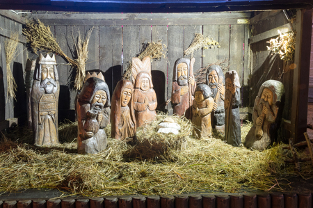 Carved wooden Nativity scene with Jesus at Christmas time.
