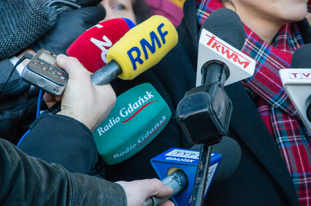 Gdansk, Poland - January 15, 2019: Microphones from different news agency at press conference. Radio zet, RMF, Trwam, Radio Gdansk and TVP gdansk microphones.