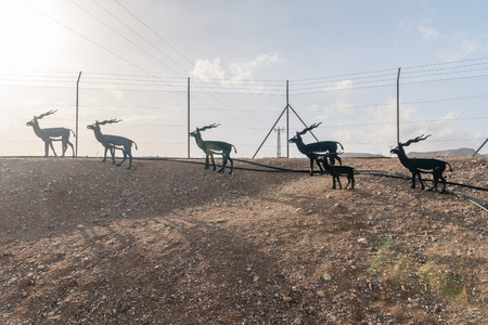 Ovda, Israel - February 7, 2019: Metal animals sculptures at civilian part of Ovda Red Sea Airport. Civilian airport.