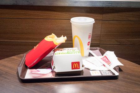 Aqaba, Jordan - February 7, 2019: McDonald Chicken Mac menu with french fries and Coca-Cola.