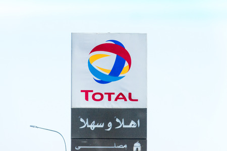 Al-Quwayrah, Jordan - February 8, 2019: Logo and sign of Total at gass station. Total is a French multinational integrated oil and gas company founded in 1924.