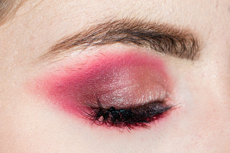 Close-up of creative make up on female eye.