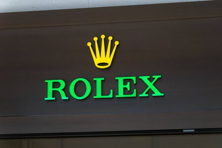 Lugano, Switzerland - June 1, 2019: Logo and sign of Rolex SA. Rolex is a Swiss luxury watch manufacturer based in Geneva, Switzerland.