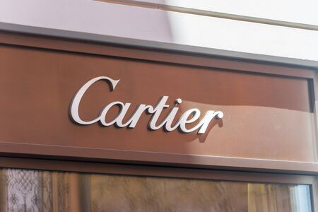 Lugano, Switzerland - June 1, 2019: Sign of luxury store Cartier. Cartier is a French luxury goods Conglomerate which designs, manufactures, distributes, and sells jewellery and watches.