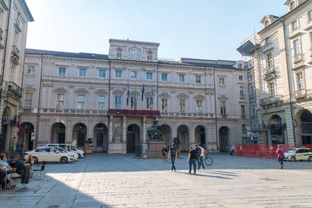 Turin, Italy - June 1, 2019: Square with Palazzo di Citta building. Turin Town Hall.