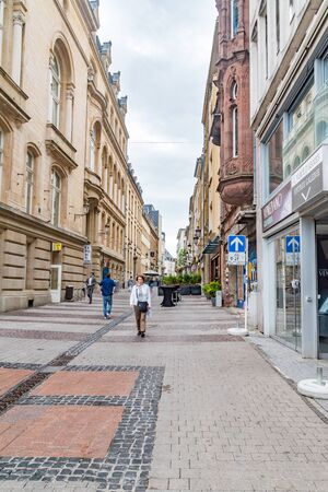 Luxembourg, Luxembourg - June 5, 2019: Small narrow street with shops and restaurants.