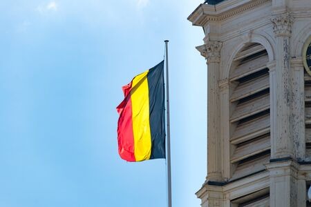 The national flag of the Kingdom of Belgium.