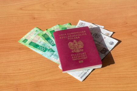 Polish biometric passport and Russian Currency.